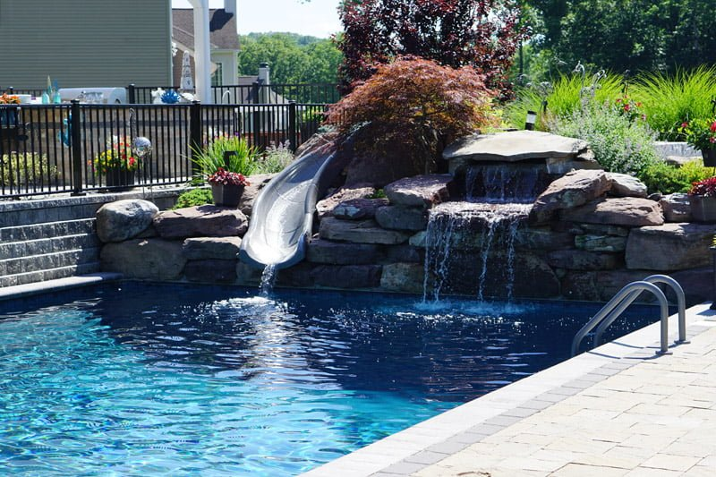 rock patio with slide and waterfall