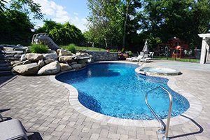 Swimming Pool with Slide and Hardscapes
